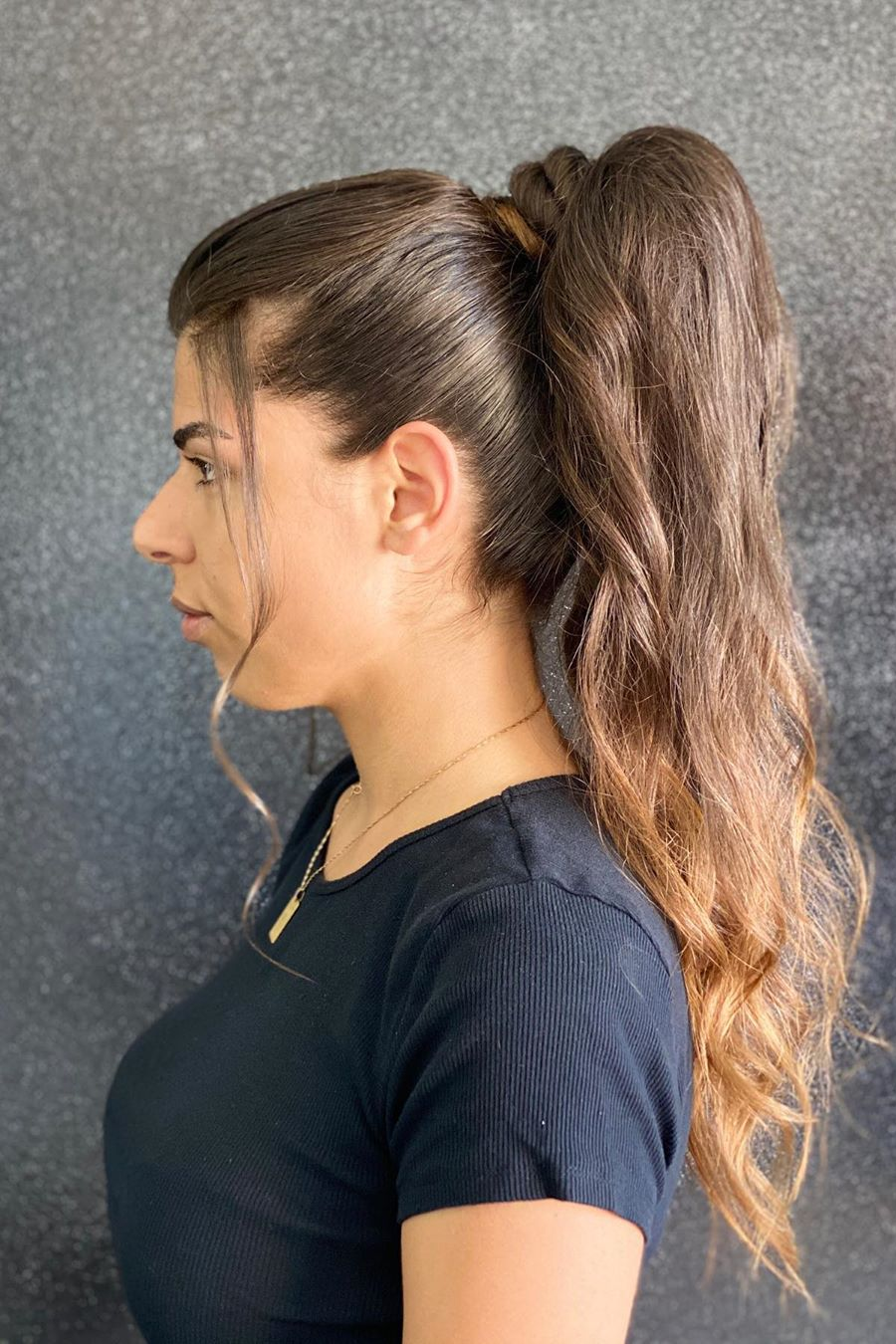messy ponytail hairstyle 2
